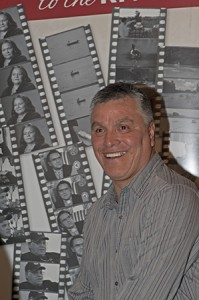 Dana Wilson in front of movie poster