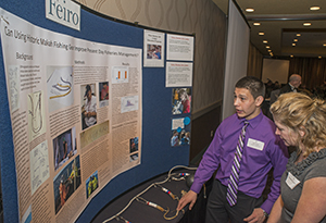 Alex Wise discusses his halibut hook project with Jacqueline Laverdure, education specialist for the Olympic Coast Marine Sanctuary prior to receiving a Student Scientist award from the Ferio Marine Life Center.