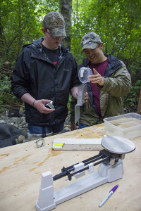 Lucas Verstegen, left, and Tyler Hansen, students at North Olympic Peninsula Skills Center, prep a smolt from Tumwater Creek for identification.  To view more, click on the photo.